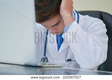 Doctor Concept. Doctors Are Making Serious Faces. The Doctor Is Stressed About Work. The Doctor Is F