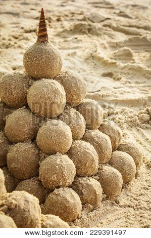 Pyramidal Sandcastle With Cone Seashell On The Top