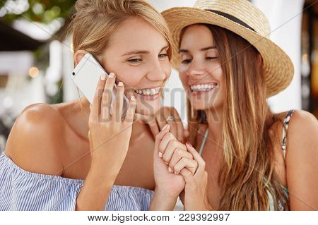 Funny Two Lesbians In Summer Clothing, Laugh Joyfully And Enjoy Togetherness As Have Resort Abroad.
