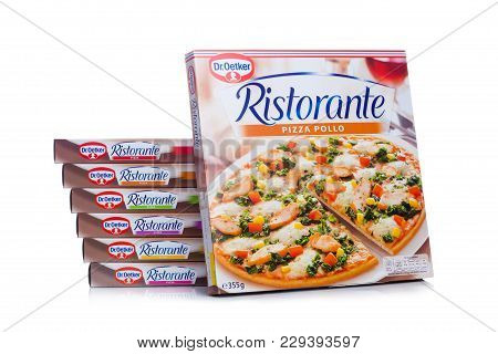 London, Uk - March 01, 2018: Boxes Of Dr.oetker Pizza Pollo On White Background With Reflection.