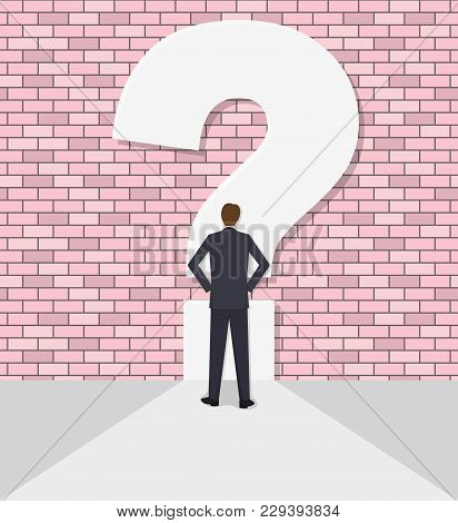 The Businessman Rests Against A Wall With A Question Mark. Concept Of An Impasse. Barrier, Obstacle,