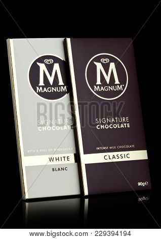 London, Uk - March 01, 2018: Luxury Chocolate Bar Of Magnum Signature Dark And White Chocolate On Bl