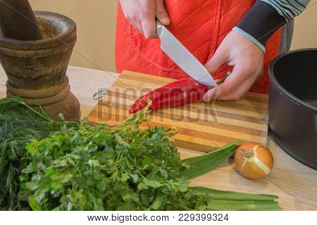 Chef Cuts The Vegetables Into A Meal. Preparing Dishes, Healthy Food. A Man Uses A Knife And Cooks.