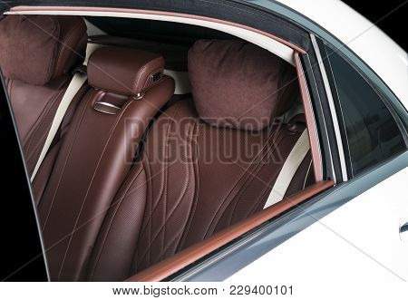Modern Luxury Car Inside. Interior Of Prestige Modern Car. Comfortable Leather Seats. Red And White