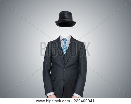 Anonymous Or Invisible Man In Suit On Gray Background.