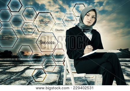 Higher Education Challenge Concept, Young Women Sitting,holding A Book And Look At Her Future