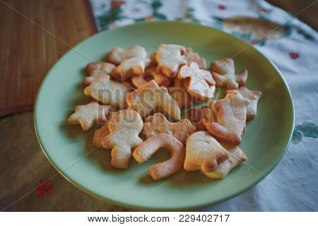 Appetizing Home-made Shortbread Cookies Lie On A Green Plate. The Table Cover Color Tablecloth. Clos