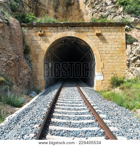 Old Train Tunnel With Railway In A Mountain