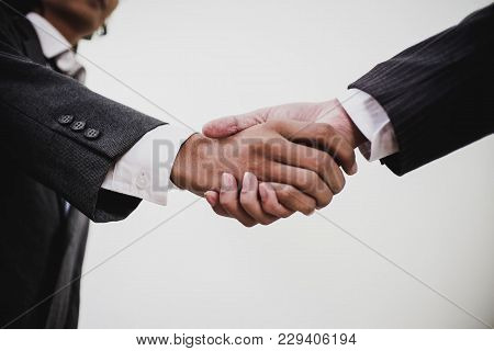 Acquisition Concept,business Partnership Shaking Hands Finishing Up A Meeting.