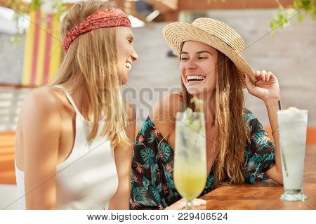Beautiful Young Women Meet Together At Bar, Have Pleasant Talk With Cocktails, Being In High Spirirt