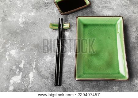Traditional Ware For Asian Food On A Gray Background. Copy Space. Food Background