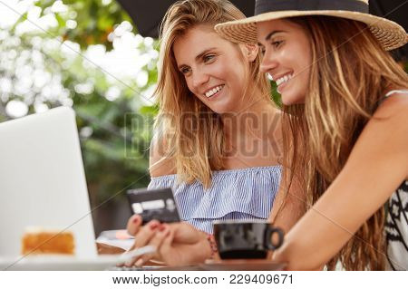People, Technology, Rest, Shopping And Banking Concept. Cheerful Homosexual Couple Spend Recreation