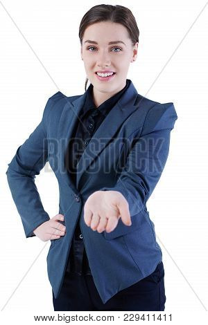 Smiling Businesswoman Showing Open Hand Palm With Copy Space For Some Product Or Slogan. Advertiseme