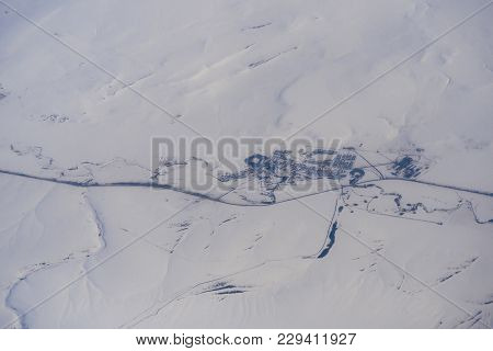 View From The Height Of The Aircraft On The Village In Snowy Siberia In Russia