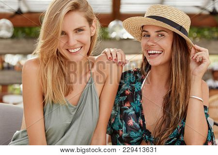 Horizontal Portrait Of Happy Women Embrace Each Other, Have Homosexual Relationships, Smile Broadly,