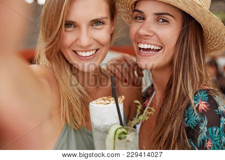 Close Up Shot Of Cheerful Young Female Best Friends With Pleasant Appearance And Broad Smiles, Pose