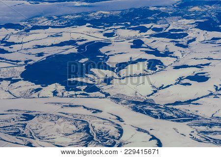 Aerial Photography From A Plane Of Lakes And Rivers In Russia In Siberia In The Snow