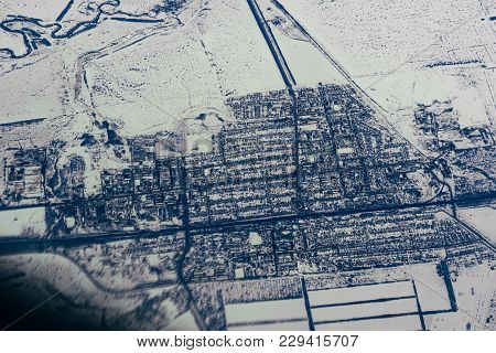 Aerial Photography From The Height Of The City Plane In The Snow In Siberia In Russia