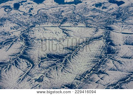 Aerial Photography From The Height Of The Aircraft Mountains In The Snow In Winter In Siberia In Rus
