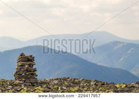 Cairns Or Rock Piles On The Top Of Mountain Overlooking  The Highlands. Pyramid Of Stones. Stone Tow