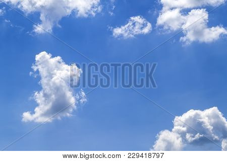 Blue Vibrant Sky With Puffy White Clouds