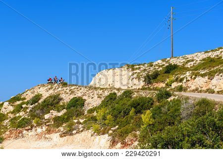 Zakynthos, Greece - October 1, 2017: Young People Driving Quads On Mountain Road. Quad Is Very Popul