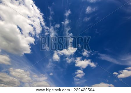 Dramatic Blue Sky With Puffy White Clouds In Bright Clear Spring Day