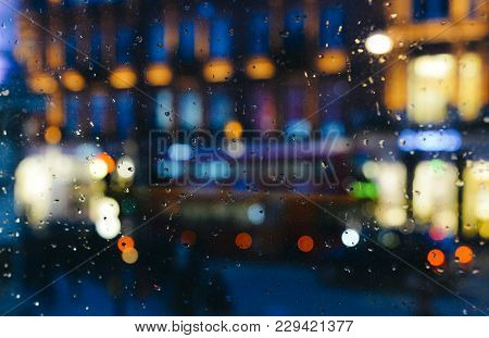 Emotional Melancholic Abstract Background With Defocused Lights Bokeh In London, Uk Behind Rain Drop