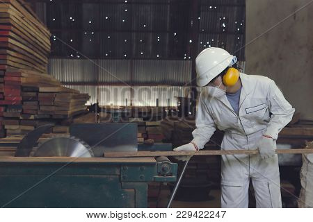 Vintage Toned Image Of Professional Young Asian Worker In White Uniform And Safety Equipment Cutting