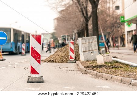 Road Traffic Sign Work Ahead With Red And White Barriers On The Street Construction Site In The City