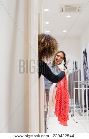 Two Young Women Trying Out New Clothes In The Cabin