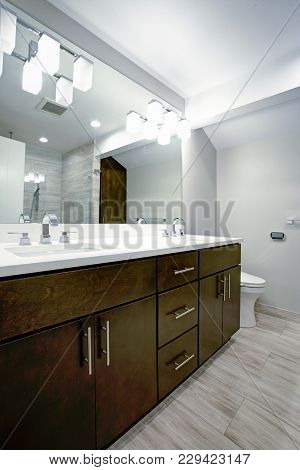 Elegant Bathroom With Espresso Double Vanity