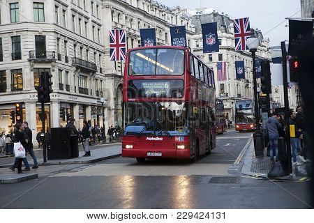 London, England - July 12, 2016 Red London Buses During The Rush Hour In Central London Taking Passe