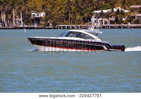 Upscale Cabin Cruiser On The Florida Intra-coastal Waterway Off Miami Beach.
