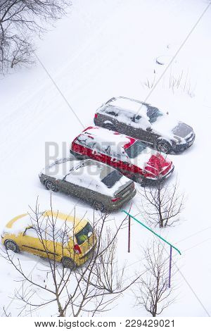 Parked Cars Covered With Snow. Bad Weather In Town. Snowy Day. Urban Scene. Weather Concept. Blizzar