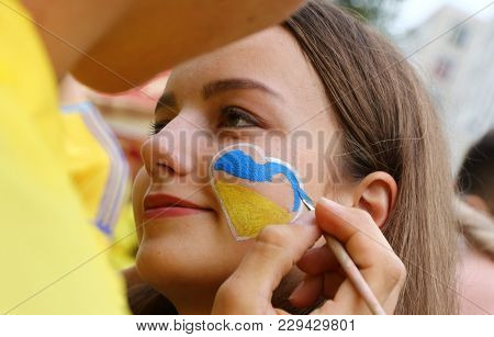 Kharkiv, Ukraine - Sep. 2, 2017: People Draw A Heart On Cheek During Fan-march Of Ukrainian National