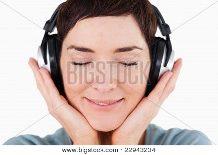 Close Up Of A Delighted Woman Listening To Music