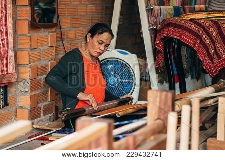 Mui Ne, Vietnam - March 6, 2017: Female Weaver Working At A Traditional Weaving Machines For Silk In
