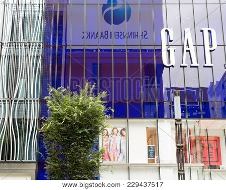 Tokyo, Japan - 24th June 2016: The modern style and architecture of the Gap store exterior in the exclusive and fashionable district of Ginza, Tokyo.