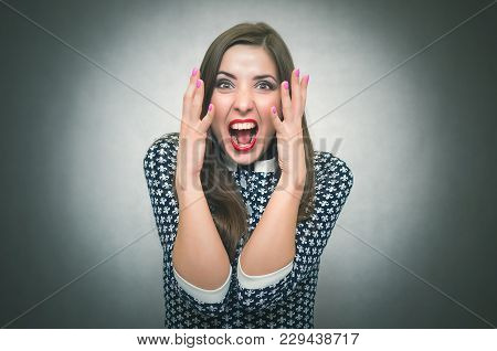 Angry Irritated Woman Is Shouting Isolated On Gray Background. Debates. Quarrel. Frightened Girl. Sc