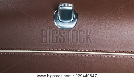 Door Handle With Lock Contol Buttons Of A Luxury Passenger Car. Brown Leather Interior Of The Luxury