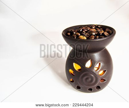 Tea Light Candle Heat Oil Perfume Diffuser With Coffee Beans On The Top. For Aroma Therapy Concept