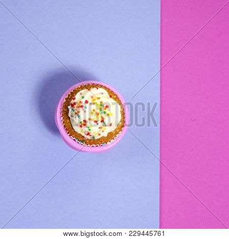 Cupcakes With White Cream On The Pink And Blue Background,