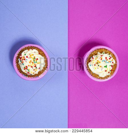 Cupcakes With White Cream On The Pink And Blue Background, Arranged For A Party Or A Wedding Recepti