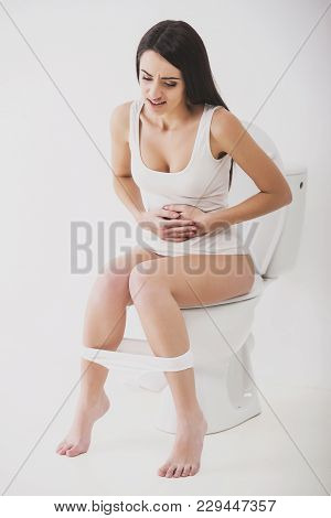 Close-up Of Woman On Toilet In Morning.