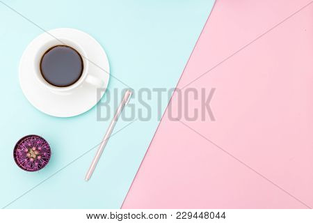 Cup Of Coffee And Pink Pen On Pastel Background. Copy Space