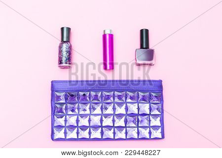 Beautician And Make-up Of A Fashionable Ultraviolet Color On A Pink Background. Flat Lay