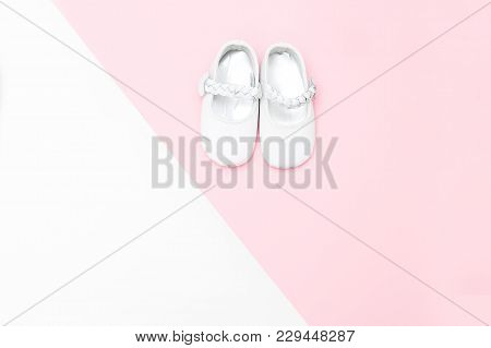 Shoes For Babe On A White And Pink Background. Copy Space