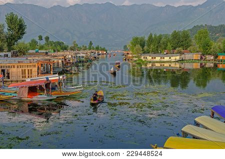 Srinagar, India - July 30, 2017: View Of Dal Lake With Houseboat And Shikara, Typical Taxi Boats In