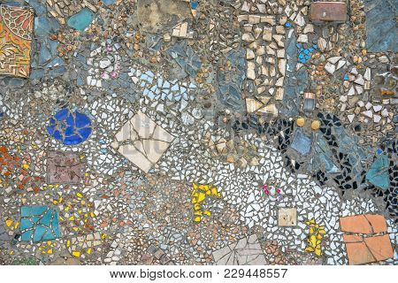Wall Made Of Colorful Mosaic Broken Tiles, Stones And Ware Splinters